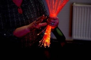 Woman in sensory room holding fiber optics